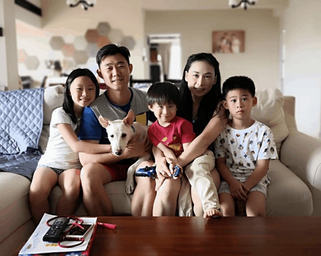 Family and their dog in the living room